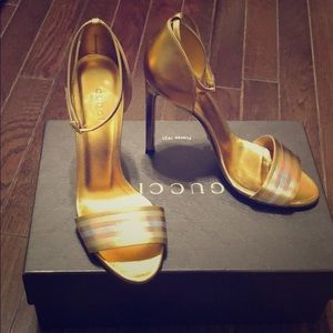 Metallic gold Gucci napa silk formal shoe.
